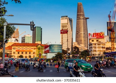 HO CHI MINH, VIETNAM - JAN 14, 2016: Architecture and motorbikes traffic on the street in Hochiminh (Saigon) on the sunset. Saigon is the largest city in Vietnam