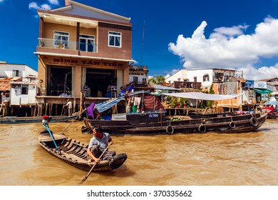 HO CHI MINH, VIETNAM - JAN 15, 2016: Life of the Vietnamese people on the Mekong River in Hochiminh (Saigon). Saigon is the largest city in Vietnam