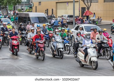 Ho Chi Minh, Vietnam - January 23, 2018: Ho Chi Minh road traffic. Mostly motorbikes drive along the road. City of motorbikes