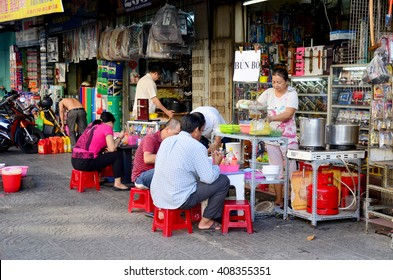 HO CHI MINH, VIETNAM - JANUARY 22 : Vietnamese people sale fruit and food at shop on street near Ben Thanh Market on January 22, 2016 in Ho Chi Minh, Vietnam