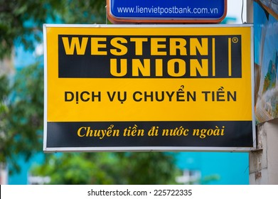 HO CHI MINH, VIETNAM - JULY 7, 2014: A sign of Western Union in the downtown. The Western Union Company is a financial services and communications company based in the United States, founded in 1851.