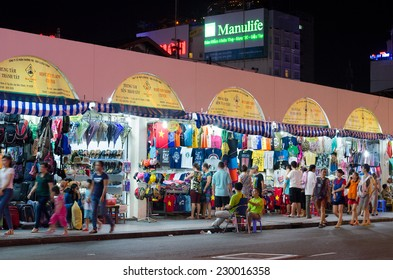 HO CHI MINH, VIETNAM - JULY 10, 2014: Unidentified people sell and buy clothes and souvenirs at the Ben Thanh market. At the market tourists can find local souvenirs and handicrafts.