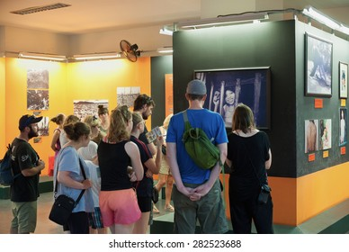 HO CHI MINH, VIETNAM - JULY 15, 2014: Unidentified tourists watch photographs at the War Remnants Museum relating to Agent Orange. This herbicide was used by the U.S. military during the Vietnam War.