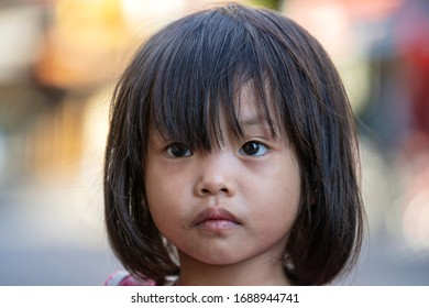 Ho Chi Minh, Vietnam - march 21, 2020 : Beggar little girl on the street in downtown Ho Chi Minh city, Vietnam