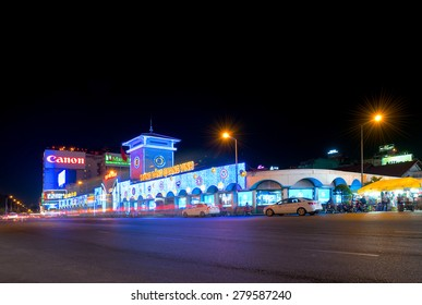 HO CHI MINH, VIETNAM - MARCH 25, 2015: The Ben Thanh Market facade with night illumination. While tourists search here souvenirs townspeople come to buy fresh food.