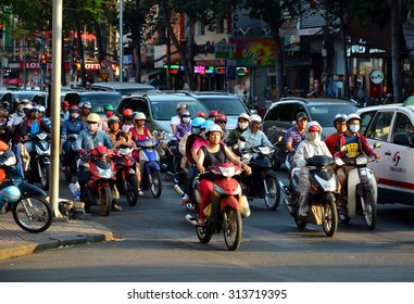Ho Chi Minh, Vietnam - March 7, 2015: Busy traffic in the old quarter 2015 in Ho Chi Minh