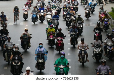 HO CHI MINH, VIETNAM - MARCH 18 2017: Rush hour, traffic sound. Unidentified thousands of motorcycles and car crowd the streets of Ho Chi Minh City also known as Saigon, the largest city in Vietnam
