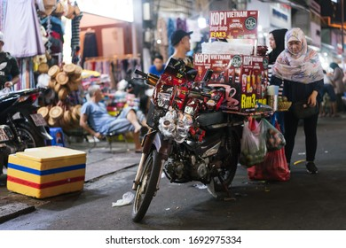 HO CHI MINH, VIETNAM - MAY 03, 2019: Vietnam K7 coffee seller using motorcycle to sell coffee in local Phan Boi Chau Night Market.