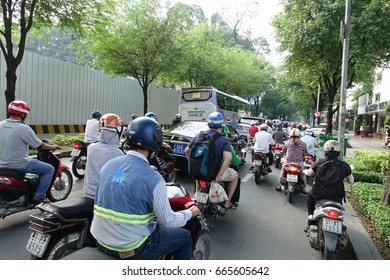 HO CHI MINH, VIETNAM - MAY 13 2017: Motorcycles crowd on streets of Ho Chi Minh City also known as Saigon, the largest city in Vietnam