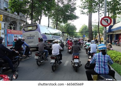 HO CHI MINH, VIETNAM - MAY 13 2017: Thousands of motorcycles crowd the streets of Ho Chi Minh City also known as Saigon, the largest city in Vietnam