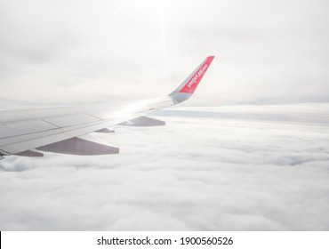 HO CHI MINH, VIETNAM - NOVEMBER, 2020: A plane of the VietJetAir airlines Airfoil and Cloudy sky. VietJetAir is a young low cost of Vietnam.