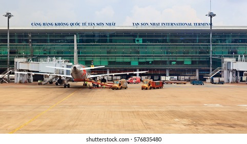 Ho Chi Minh, Vietnam - September 5, 2015: Aircraft of asian low cost airline Jet Star Air preparing for flight in front of passenger terminal building in Ho Chi Minh ( Saigon ) International Airport.
