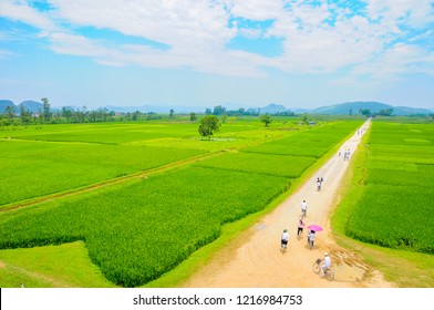 Ho Citadel, Thanh Hoa Province, Vietnam - May 9, 2014. Schoolchildren cycling towards the north gate of the Ho Citadel, which became a UNESCO World Heritage Site in 2011.