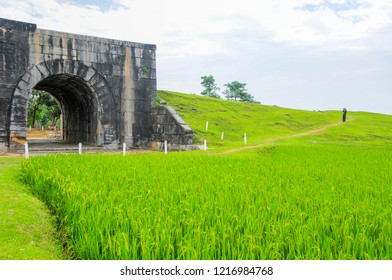Ho Citadel, Thanh Hoa Province, Vietnam - May 9, 2014. Photographer taking picture of the south gate. The citadel became a UNESCO World Heritage Site in 2011.