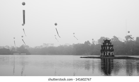 Ho Hoan Kiem, the little lake in the old part of Hanoi, Vietnam, with the Tortoise Tower.