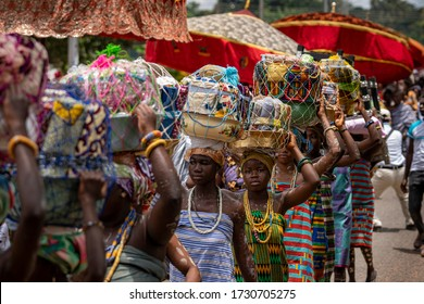Ho, Volta / Ghana - September 14, 2018: Woman and girls march in a procession carrying gifts on their heads for the Paramount Chief during a Festival in rural Ghana, West Africa.