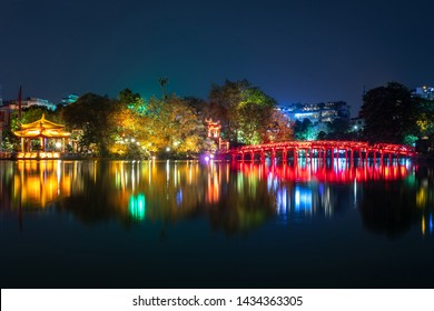 Hoan Kiem Lake in Vietnam with temples and red bridge at night. Temple of Jade Mountain and Turtle island are landmark of Hanoi, Vietnam.