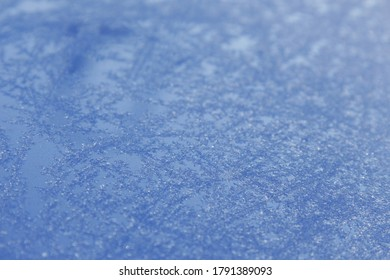 hoar and ice flowers on the blue surface