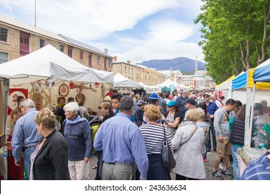 HOBART, AUSTRALIA - 27 DECEMBER 2014: Shoppers browse the stalls at the Salamanca Markets in Hobart, Tasmania