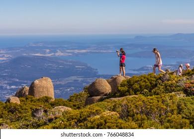 Hobart, Australia - 7 January 2017: people on stunning summit of Mount Wellington overlooking Hobart and the south coast of Tasmania