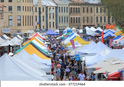 HOBART AUSTRALIA - MARCH 15, 2014: Unidentified people shop at Salamanca Market - Hobart is the state capital of Tasmania and Australia's second oldest capital city after Sydney.