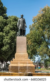 Hobart, Australia - March 19. 2017: Tasmania. Bronze statue of Rear Admiral Sir John Franklin shows him looking proudly. Green park background with fountain and blue sky.