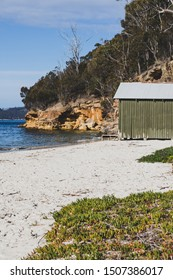 HOBART, AUSTRALIA - September 9th, 2019: view of Conningham Beach in Tasmania with its pristine rugged coastal beauty and the typical beach huts