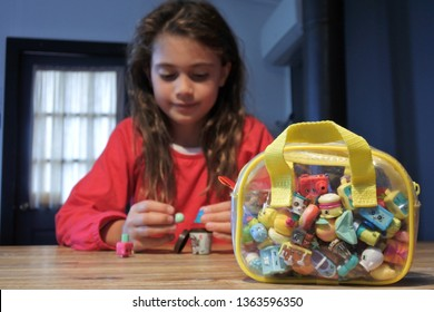 HOBART - MAR 19 2019:Young girl (Talya Ben Ari age 8) playing with Shopkins a range of tiny collectable toys manufactured by Moose Toys.Each plastic figure has a recognizable face and unique name.
