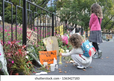HOBART - MAR 21 2019:Two girls looking at tributes to honour Christchurch mosque shooting victims in Christchurch in the South Island of New Zealand during Friday Prayer on 15 March 2019.