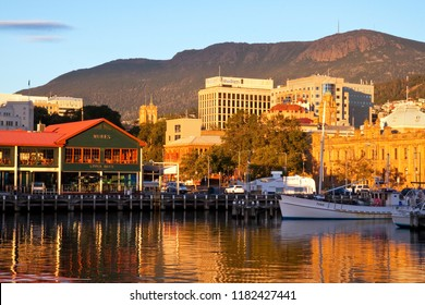 HOBART, TASMANIA, AUSTRALIA - 13 MARCH 2014: Hobart city skyline and Mount Wellington viewed from the waterfront at Victoria Harbour early in the morning.