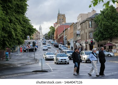 Hobart, Tasmania / Australia - November 8 -2012: People walking around a busy street in Hobart. Cars in the background and city buildings.