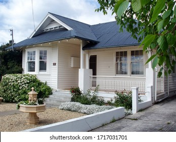 Hobart, Tasmania, Australia, October 21, 2005: View of the front yard of a white weatherboard house in suburban  Hobart