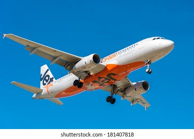 HOBART, TASMANIA/AUSTRALIA, MARCH 13TH: Image of a Jetstar passenger airliner  landing at Hobart Airport on 13th March, 2014 in Hobart