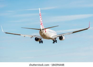 HOBART, TASMANIA/AUSTRALIA, MARCH 20TH: Image of a Virgin Australia passenger airliner landing at Hobart Airport on 20th March, 2014 in Hobart