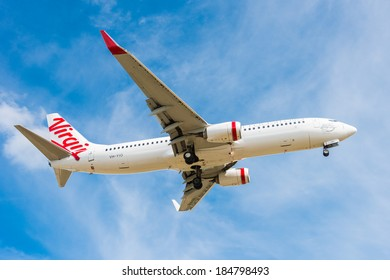 HOBART, TASMANIA/AUSTRALIA, MARCH 31ST: Image of a Virgin Australia passenger airliner landing at Hobart Airport on 31st March, 2014 in Hobart