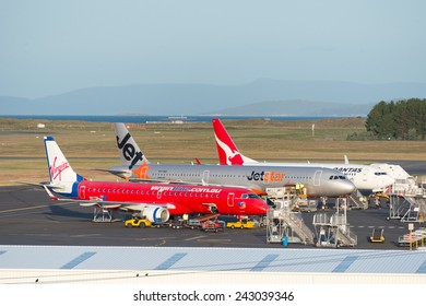 HOBART, TASMANIA/AUSTRALIA, MAY 11TH: Image of a Virgin Blue, Jetstar and Qantas passenger airliner at Hobart Airport on 11th May, 2014 in Hobart