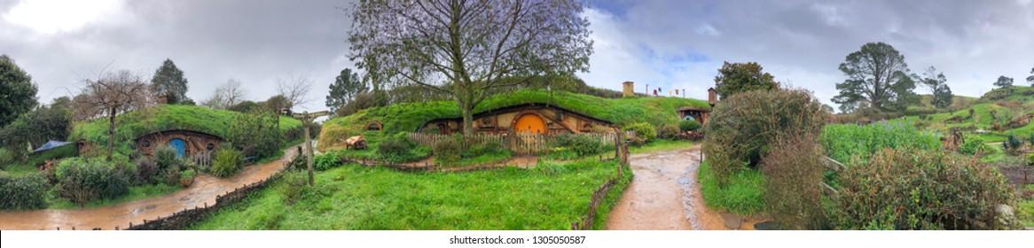Hobbit houses in Hobbiton, New Zealand. Panoramic view of beautiful countryside in winter.