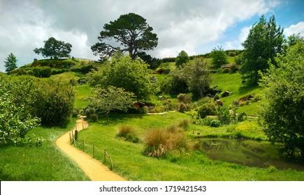Hobbiton Movie Set, Matamata, New Zealand - 11 20 2019: Hobbiton, Matamata, New Zealand - Hobbit and Lord of the Rings Movie Set. Beautiful Shire village, panorama.