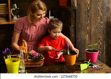 Hobby concept. Little child help woman planting flower in pot with soil, hobby. Indoor gardening as hobby. Enjoy family hobby activity.