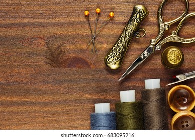 Hobby needlecraft concept with vintage instruments horizontal flat view on red wooden background