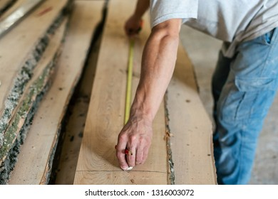 Hobby wood concept. Profile side view cropped photo of cabinetmaker or mature handyman hold measuring tape in hands make furniture in garage or workroom
