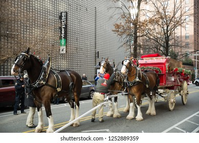 Hoboken, NJ: December 8 2018 - The Budweiser Clydesdale horses are setting up and are out delivering beer for the christmas holiday season in  New Jersey Horses are dressed in festive outfits