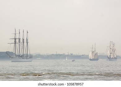 HOBOKEN, NJ - MAY 23: Tall ships sail on the Hudson River towards Manhattan during the Parade of Sails on May 23, 2012 in Hoboken, NJ. The parade marks the beginning of Fleet Week.