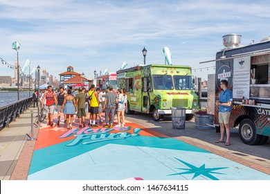 Hoboken, NJ / USA Jun 2019: Street food trucks broad walk in Hoboken, line to street food.