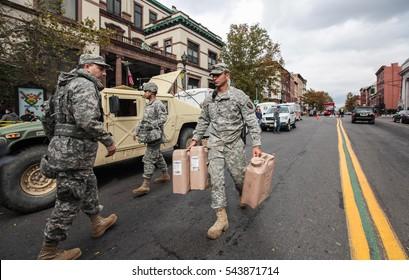 Hoboken, NJ, USA - November Circa 2012: New York after Sandy the hurricane.  National Guard helps people on Hoboken streets.