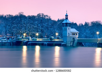 The Hochablassa, a famous barrier at the river Lech in Augsburg/Germany. The picture shows the bridge an the generator house at early morning before sunrise with the lights on.