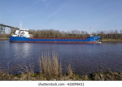 HOCHDONN, GERMANY - APRIL, 2. The general cargo vessel Fehn Caledonia at the Kiel Canal near Hochdonn (Germany, Schleswig Holstein) on April 2, 2016.