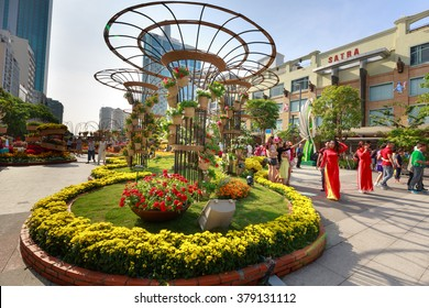 Hochiminh City, Vietnam - February 07, 2016: Nguyen Hue walking street with icons of green chung cake, watermelon, yellow apricot flowers. It created warm atmosphere to evryone welcoming the New Year