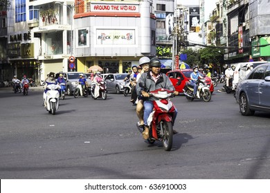 HOCHIMINH CITY, VIETNAM - February 24, 2017: Amazing traffic of Asia city, group citizen on privaet vehicle in rush hour, mob of people in helmets, riding motorcycles in Vietnam, February 24, 2017