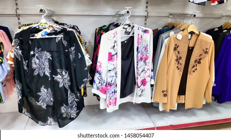 Hochiminh city, Vietnam - July 01 2019: Beautiful fashionable women clothes various size top dresses blazers on supermarket shelf colorful design wardrobe rack